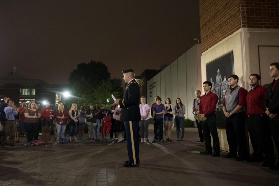 Assistant+Professor+of+Military+Science+Maj.+Stephan+Walters+addresses+students+and+staff+in+front+of+Guthrie+Bell+Tower+at+a+candlelight+vigil+to+commemorate+the+September+11th%2C+2001+terrorist+attacks.