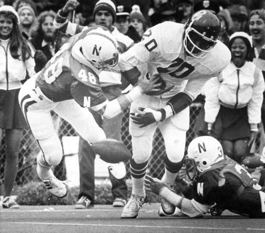 Nebraska's Jeff Hansen strips the ball from Oklahoma's Billy Sims during the 1978 game at Memorial Stadium. The fumble preserved NU's 17-14 victory against the top-ranked Sooners.