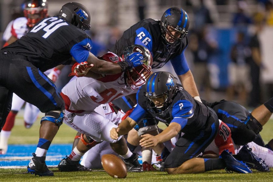 Sophomore quarterback Austin Grammer fumbles and recovers the ball during the first half the WKU vs Middle Tennessee State game in Murfreesboro on Sept. 13, 2014. Nick Wagner/HERALD