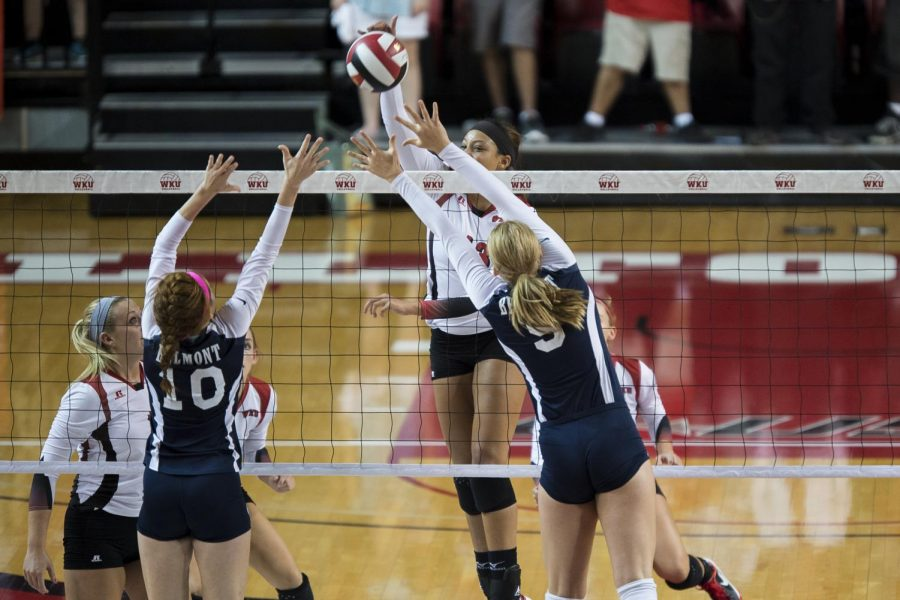 Junior+middle+hitter+Noelle+Langenkamp+%2813%29+spikes+the+ball+for+a+point+as+Belmont%27s+Arianna+Person+%2810%29+and+Scarlet+Gable+%289%29+try+to+block+during+WKU%27s+3-0+sweep+over+Belmont+on+Tuesday%2C+Sept.+2+in+Diddle+Arena+in+Bowling+Green.+Mike+Clark%2FHERALD