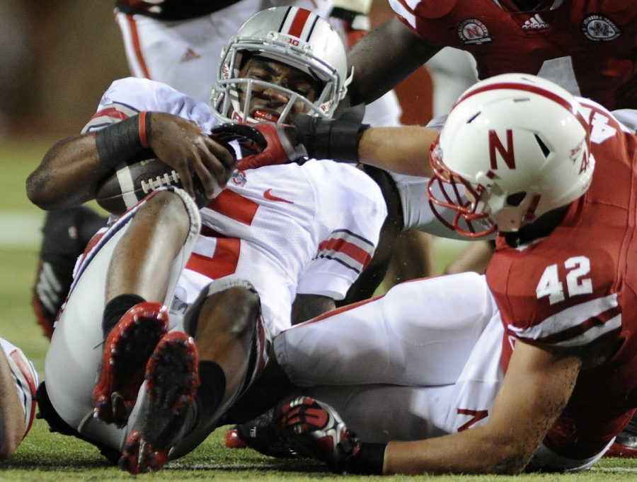 Ohio State quarterback Braxton Miller (5) is injured on a third-quarter tackle by Nebraska linebacker Sean Fisher at Memorial Stadium. Once Miller left the game, the Buckeyes' offense was never the same and NU rallied for a 34-27 victory.