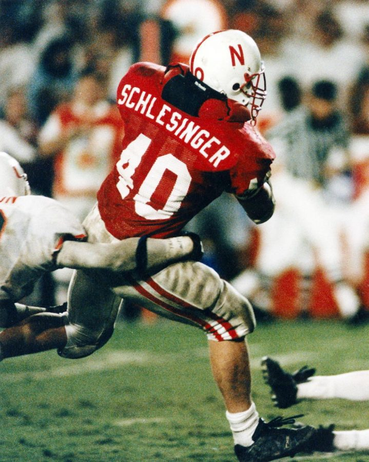 Fullback Cory Schlesinger breaks a tackle on his way to scoring the winning touchdown against Miami in the 1995 Orange Bowl. The Huskers' 24-17 victory gave Tom Osborne his first national title.