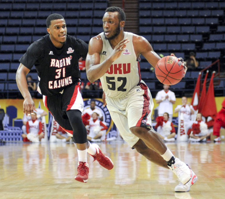WKU junior guard T.J. Price drives the ball pass ULL junior guard Kevin Brown during the 2014 Mens Sun Belt Tournament semifinal round at the Lakefront Arena in New Orleans, La. on Saturday Mar. 15, 2014. (Jeff Brown/HERALD)