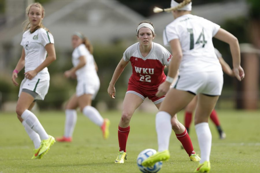 WKU+junior+defender+Alanna+Clancy+%2822%29+stands+in+the+way+of+a+Charlotte+player+Sunday+October+5%2C+2014+during+WKU%27s+first+Conference+USA+matchup+of+the+season.+Despite+Clancy%27s+efforts+WKU+would+go+scoreless+in+a+3-0+loss.%C2%A0Luke+Franke%2FHERALD