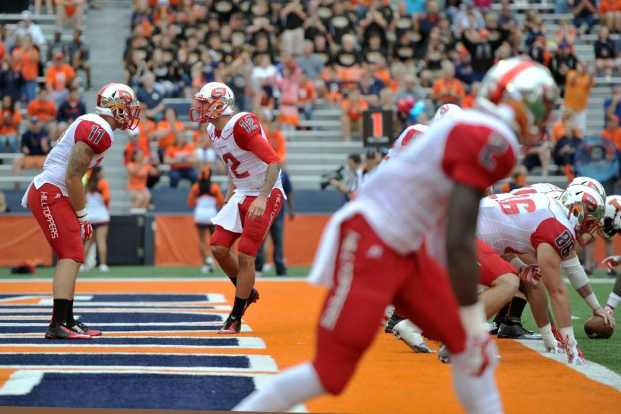 Brandon Doughty calls plays to his team at the WKU vs Illinois game. WKU is leading at halftime 17-14 against Illinois on Saturday Sept. 06, 2014 at Memorial Stadium in Champaign, Ill. Jeff Brown/HERALD