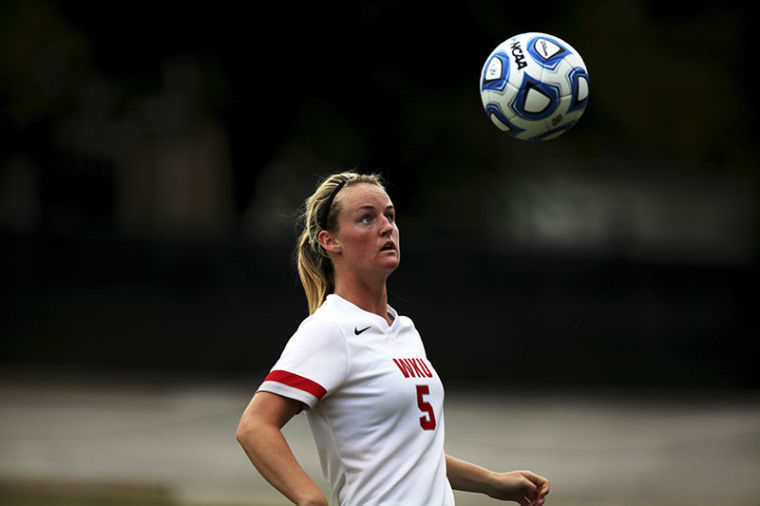 Lady+Toppers+sophomore+forward%2Fmidfielder+Lauren+Moats+waits+for+the+ball+to+drop+after+being+kicked+down+the+field.+WKU+played+against+the+University+of+Memphis+and+lost%2C+1-0.%C2%A0