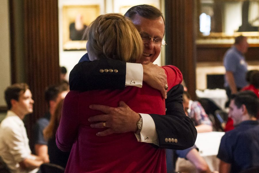 President+Gary+Ransdell+embraces+Gilbert+Hall+Director+Samantha+Hartman+during+a+casual+dinner+for+faculty%2C+staff+and+students+who+are+part+of+the+WKU+LGBTQ+community+at+the+Kentucky+Museum+on+Monday.+During+the+gathering%2C+Ransdell+addressed+concerns+about+gender-neutral+bathrooms+on+campus+and+emphasized+the+importance+of+each+student+feeling+included+in+the+WKU+community.+Jennifer+King%2FHERALD