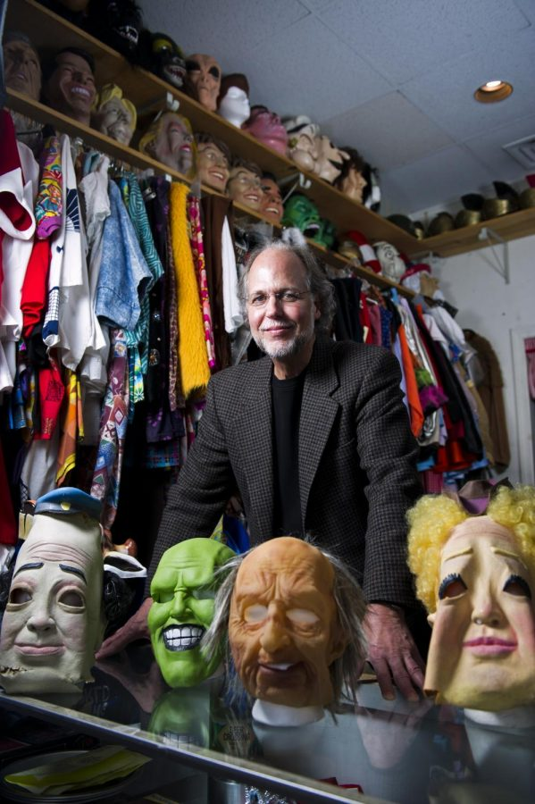 Nick Wilkins stands in his store, Balloon-A-Gram, on Tuesday. Wilkins offers a large supply of costumes available for sale and rent, including clown outfits, Elvis outfits and classic, scary masks and outfits. When hes not manning his store, Wilkins keeps busy with hundreds of clowning performances that he books throughout the year. Nick Wagner/HERALD