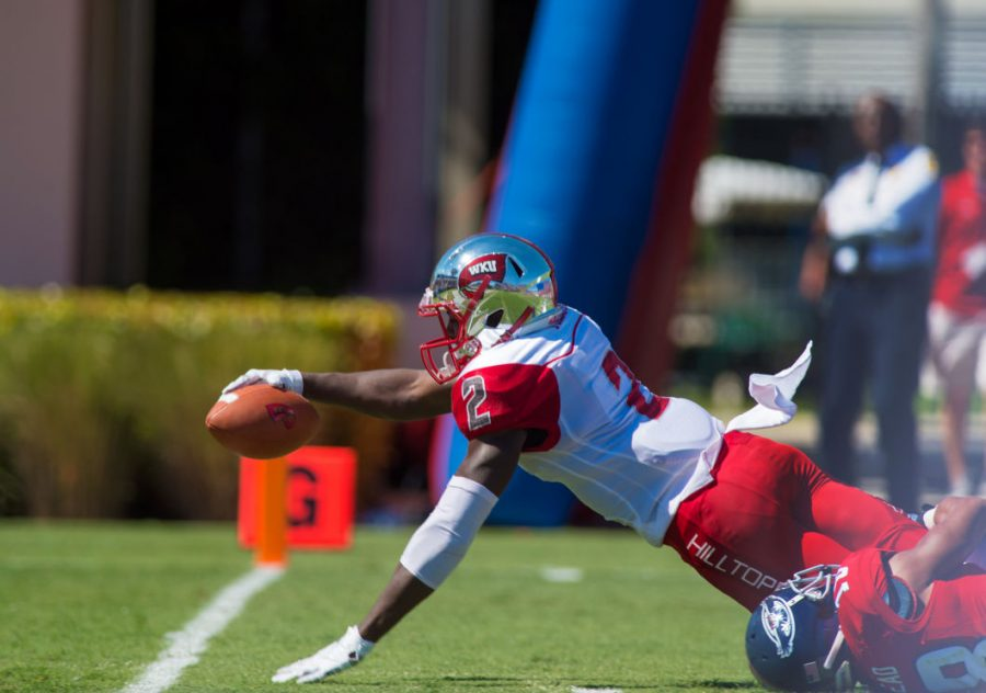 WKU+sophomore+wide+receiver+Taywan+Taylor+%282%29+reaches+for+a+touchdown+in+the+WKU+vs.+Florida+Atlantic+game+on+Oct.+18.+The+Hilltoppers+lost+45-38+despite+holding+a+17-point+halftime+lead.+MAX+JACKSON%2FCOURTESY+OF+UNIVERSITY+PRESS+AT+FAU