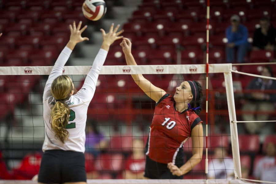Junior outside hitter Haley Bodway goes up for a spike against a North Texas defender during WKU's match on Sunday. Bodway racked up 10 kills as WKU defeated UNT in four sets. Brandon Carter/HERALD