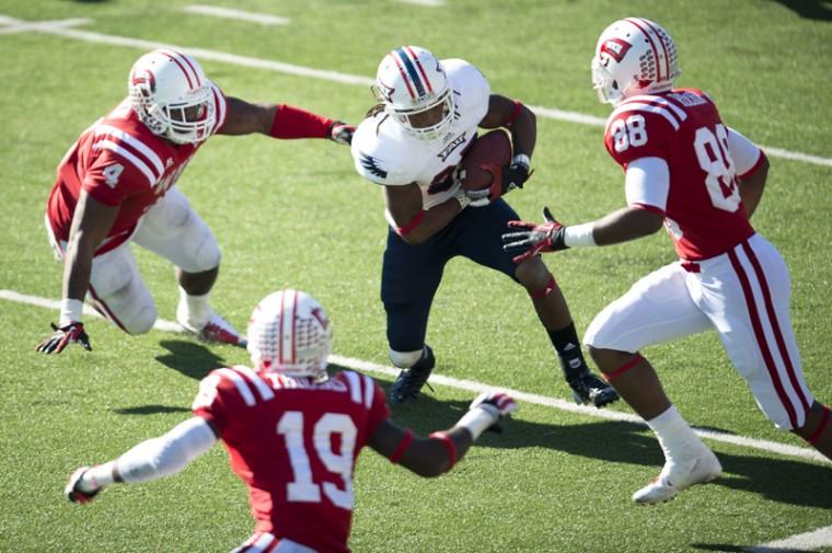 WKU defense surrounds FAU running back Travis Jones during the Hilltoppers vs. Florida Atlantic game on Saturday, November 10, 2012.