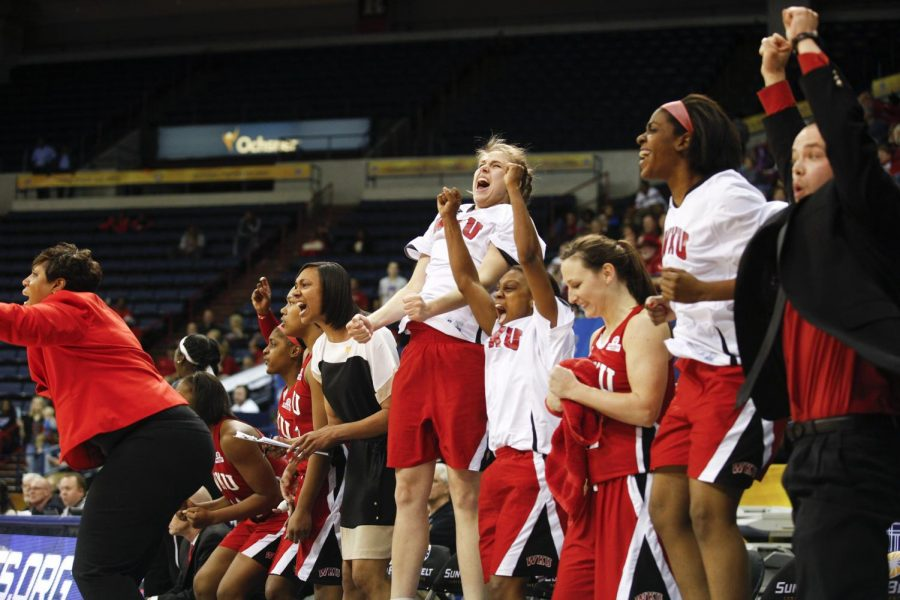 The Lady Toppers bench cheers as WKU rallies in the final minutes of their 61-60 victory over Arkansas State in the championship game of the Sun Belt Tournament Saturday, March 15, 2014, at Lakefront Arena in New Orleans, La. The Lady Toppers secured a place in the NCAA tournament with their win. (Mike Clark/HERALD)