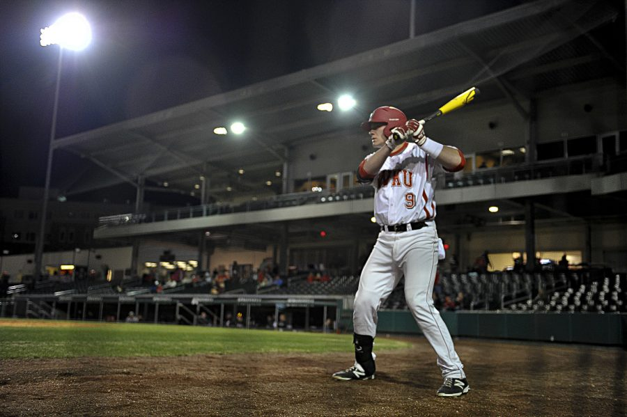 WKU freshman Hunter Wood warms up to bat in the bottom of the 8th inning during WKU's 5-3 lost against Louisville at the Bowling Green Ballpark in Bowling Green, Ky on Wednesday March 26, 2014. (Jeff Brown/HERALD)