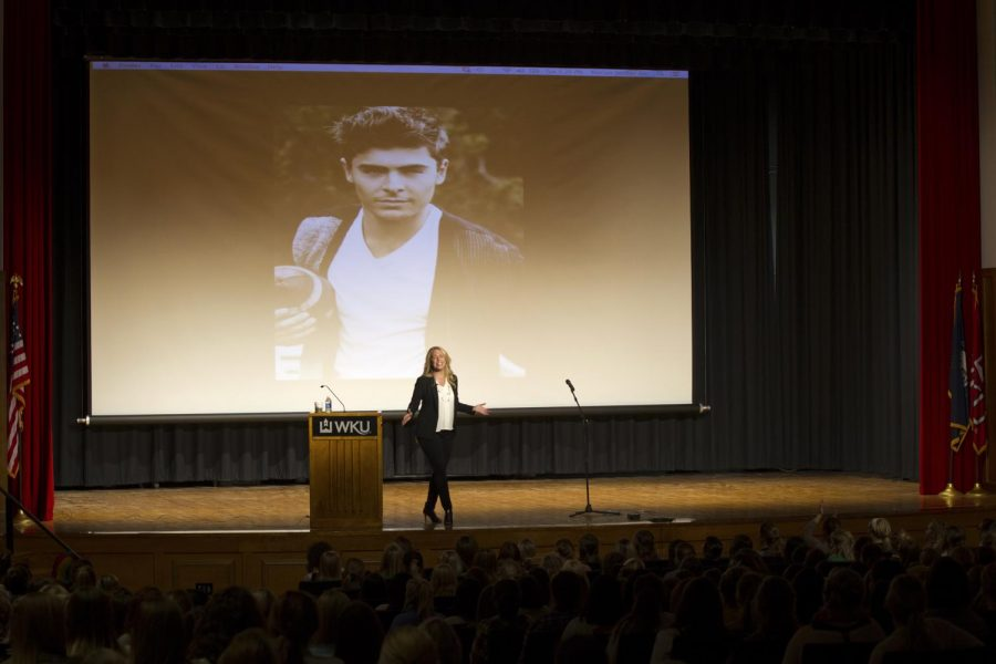 A photo of Zac Efron isprojected behind MarianJordan Ellis, author of