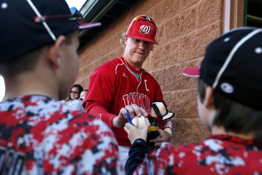 Senior+infielder+Scott+Wilcox+signs+baseballs+for+fans+after+WKUs+win+against+Arkansas+State+at+Nick+Denes+Field+on+April+5.+%28Ian+Maule%2FHERALD%29