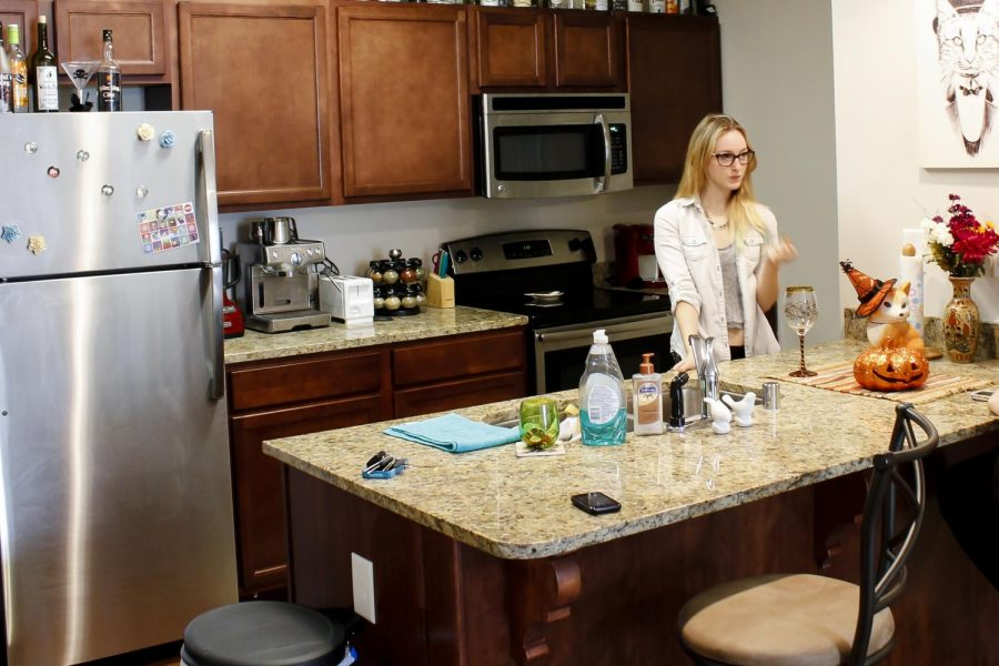 Owensboro junior Courtney Hamilton and Louisville junior Emily Woodruff are residents in the newly constructed Kentucky Street Apartments owned by WKU. The apartments feature a kitchen, bedrooms, a washer and dryer, a bathroom and a living room. Jennifer King/HERALD