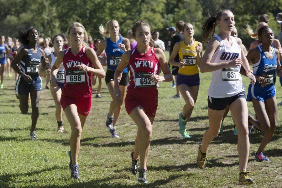 WKU sophomore cross country runners Baylee Shofner and Taylor Carlin compete in the Vanderbilt Commodore Classic on Sept. 14, 2013. Luke Franke/HERALD