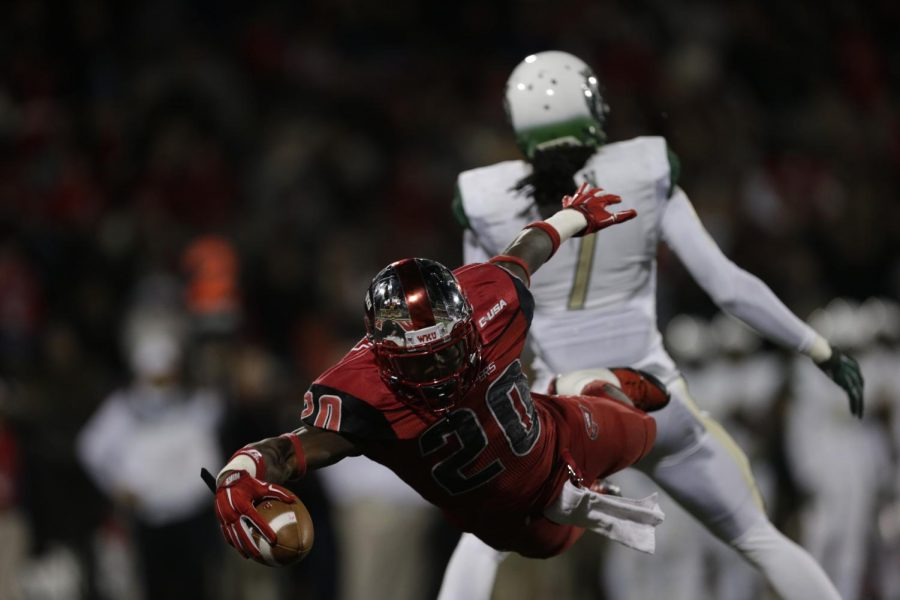 WKU redshirt sophomore running back Anthony Wales (20) makes a superman dive into the end zone during the first half against Conference USA opponent University of Alabama-Birmingham (UAB) Saturday October 4, 2014 at Smith Stadium in Bowling Green, Ky. Despite rushing for 138 yards and three scores Wales could not propel the Hilltoppers to victory in a disappointing 42-39 loss that saw the WKU defense allow 591 yards on offense, a season high.Luke Franke/HERALD