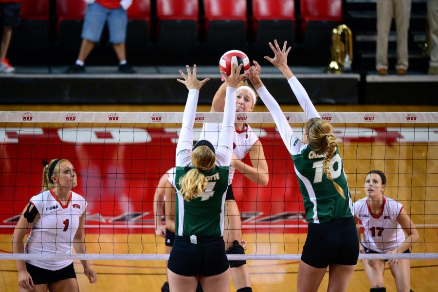 WKU+senior+middle+hitter+Heather+Boyan+%283%29+spikes+the+ball+as+two+Charlotte+players+block+on+Oct.+7.+Harrison+Hill%2FHERALD