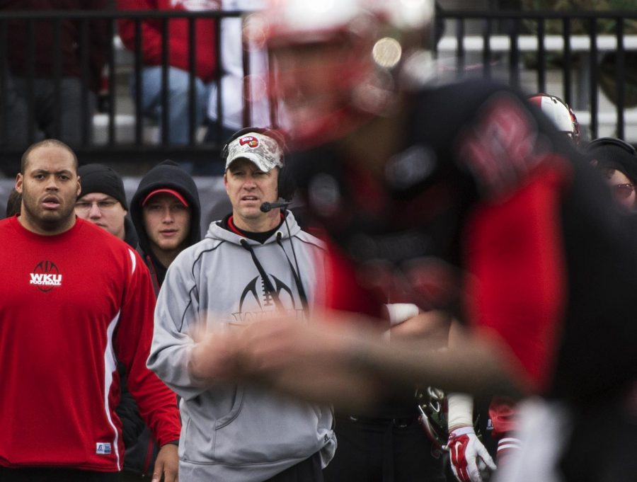 Hilltopper's head coach Jeff Brohm looks on as quarterback Brandon Doughty readies to hut the ball during Saturday's game against Army at Houchens-Smith Stadium in Bowling Green, Ky.Nick Wagner/HERALD