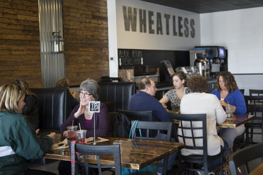 Patrons talk amongst themselves during the lunch rush at WheatLess, a gluten-free restaurant located in Buckhead Square. The menu at WheatLess offers a variety of gluten-free food options and includes breakfast, lunch and dinner. Alyssa Pointer/HERALD