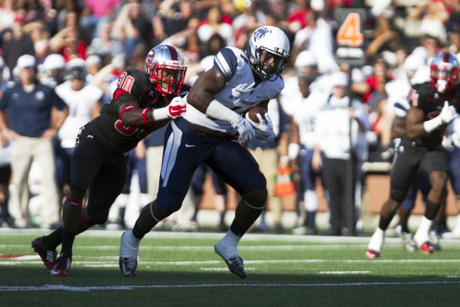 Redshirt junior defensive back Prince Charles Iworah (30) reaches to tackle Old Dominions Melvin Vaughn during the first half of the Old Dominion game on Saturday. Brandon Carter/HERALD