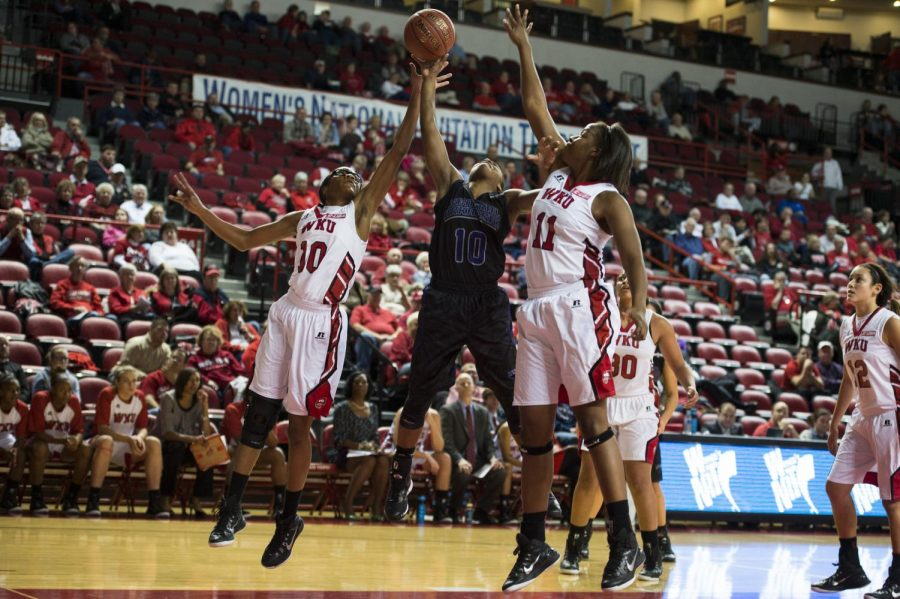 Freshman guard Tashia Brown (10) and sophomore center Bria Gaines (11) battle Central Arkansas guard Brianna Mulltins (10) for a rebound during the Lady Toppers Nov. 14 game against the Sugar Bears. WKU defeated UCA 93-57 to advance in the Preseason Womens NIT. Nick Wagner/HERALD
