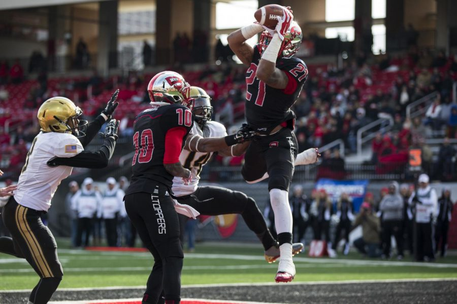 Redshirt+junior+wide+receiver+Jared+Dangerfield+%2821%29+catches+a+six-yard+touchdown+pass+from+senior+quarterback+Brandon+Doughty+during+the+second+half+of+WKU%27s+game+against+Army+on+Nov.+15.+Dangerfield+caught+seven+passes+for+73+yards+and+a+touchdown+in+the+Hilltoppers%27+52-24+victory+over+the+Black+Knights.+Brandon+Carter%2FHERALD