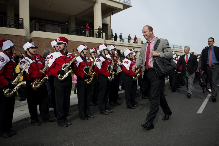 WKU Head Coach Jeff Brohm makes his way onto Feix field before the WKU v. UTEP homecoming football team. This is Brohm's first homecoming game while head coach.William Kolb/HERALD