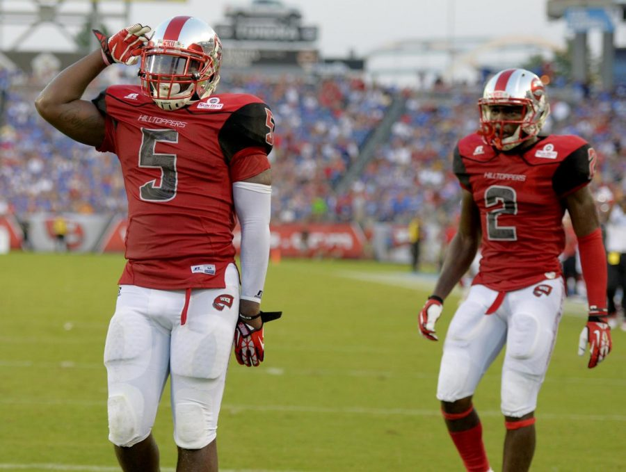 WKU senior running back Antonio Andrews salutes after scoring a touchdown in the second quarter against Kentucky.