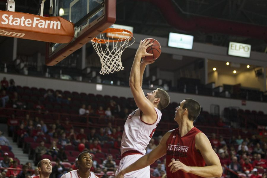 Freshman+forward+Justin+Johnson+%2823%29+attempts+to+dunk+the+ball+during+the+Hilltopper+Hysteria+scrimmage.%C2%A0