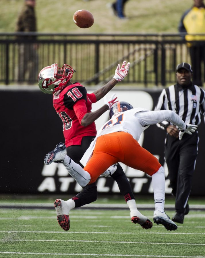 WKU wide receiver Willie McNeal eyes a deflected pass during the first half of Saturday's game at Houchens-Smith Stadium in Bowling Green, Ky. McNeal successfully caught the ball before running for a touchdown.Nick Wagner/HERALD