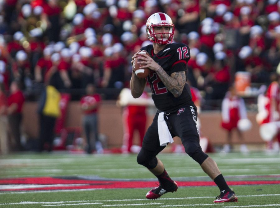 Redshirt+senior+quarterback+Brandon+Doughty+%2812%29+drops+back+for+a+pass+during+the+third+quarter+of+WKU%27s+Oct.+25+game+against+Old+Dominion.+Doughty+went+23+of+26+for+371+yards+and+five+touchdowns%2C+leading+WKU+to+a+66-51+victory+over+the+Monarchs.+Brandon+Carter%2FHERALD