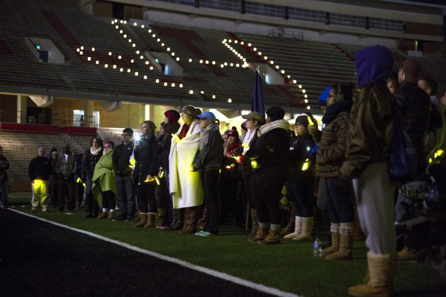 Participants+in+the+2014+Relay+for+Life+event+listen+during+the+Luminaria+Ceremony%2C+honoring+those+who+have+fought+or+are+currently+fighting+cancer.+Lit+luminaries+in+the+bleachers+formed+the+hand+sign+for+I+love+you+in+honor+of+the+Sparks+family.+Brandon+Carter%2FHerald