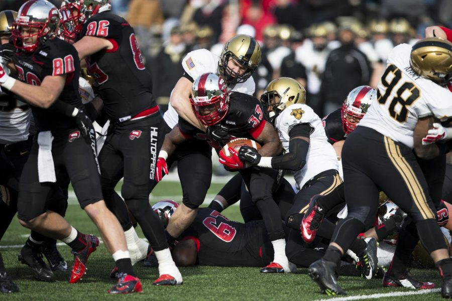 Junior running back Leon Allen (33) pushes through the line on a rush during the second half of the WKU-Army game on Nov. 15. Allen rushed 33 times for 345 yards and three touchdowns, breaking the Conference USA record for rushing yards in a single game. Brandon Carter/HERALD