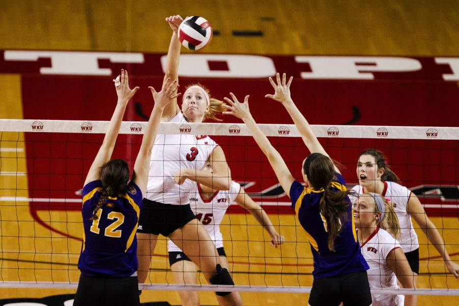 Senior+middle+hitter+Heather+Boyan+spikes+the+ball+against+Tennessee+Tech+Tuesday+night+at+Diddle+Arena.+Luke+Franke%2FHERALD