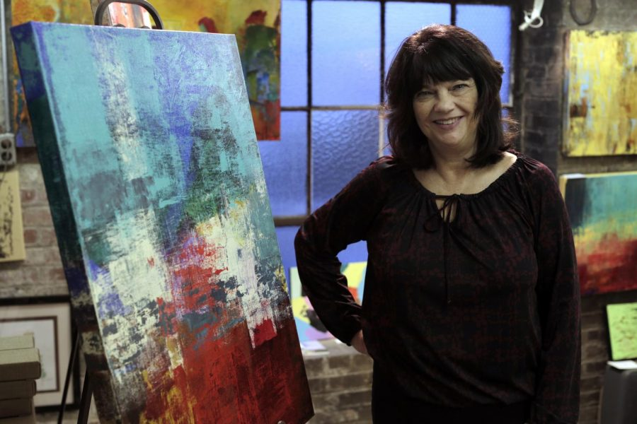Myra+Dwyer+poses+with+her+paintings+in+the+Pushin+Building+Artist+Studio.+Dwyer+has+been+painting+for+nine+years+and+is+co-manager+of+the+studio+alongside+Angie+Alexieff+.+Bria+Granville%2FHERALD