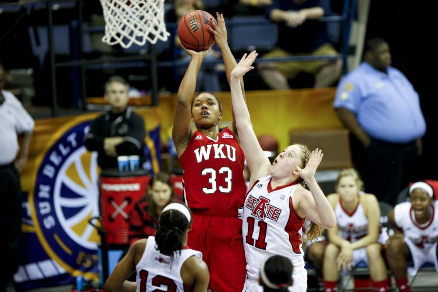 WKUs sophomore forward Jalynn McClain (33) shoots over ASUs forward Jane Morrill (11) during the first half of WKUs 61-60 victory Arkansas State in the championship game of the Sun Belt Tournament Saturday, March 15, 2014, at Lakefront Arena in New Orleans, La. The Lady Toppers secured a place in the NCAA tournament with their win. (Mike Clark/HERALD)