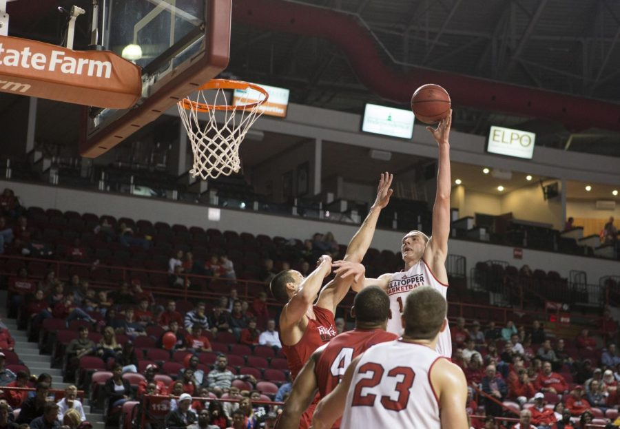 Sophomore+forward+Ben+Lawson+%2814%29+goes+for+a+layup+over+teammate+Alexsej+Rostov+%2820%29+during+the+men%27s+scrimmage+at+Hilltopper+Hysteria+on+Oct.+18+at+Diddle+Arena.+Lawson+scored+19+points+as+the+White+Team+fell+to+the+Red+Team+43-41.+Brandon+Carter%2FHERALD