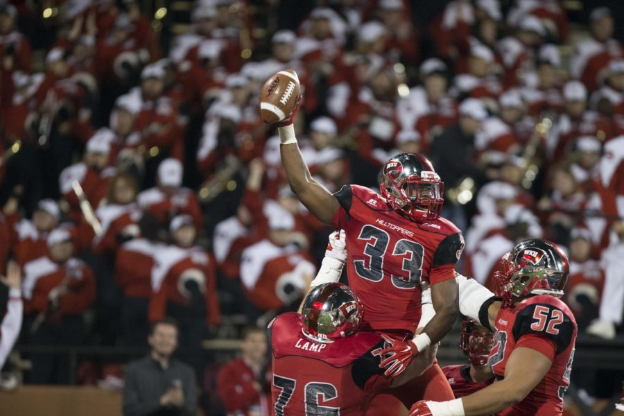 Junior+running+back+Leon+Allen+%2833%29+celebrates+with+teammates.+The+Hilltoppers+defeated+the+UTEP+Miners+35-27.+Mike+Clark%2FHERALD