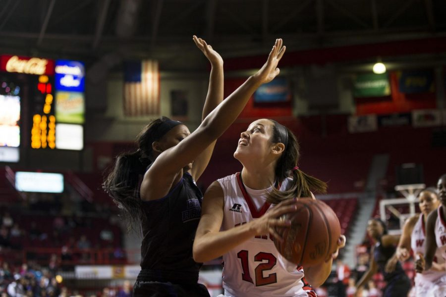 Redshirt sophomore guard Kendall Noble (12) goes up for a shot against a Central Arkansas defender during the Lady Toppers Nov. 14 game against Central Arkansas. Noble scored 17 points and snagged 12 rebounds in WKUs 93-57 victory over the Sugar Bears. Brandon Carter/HERALD