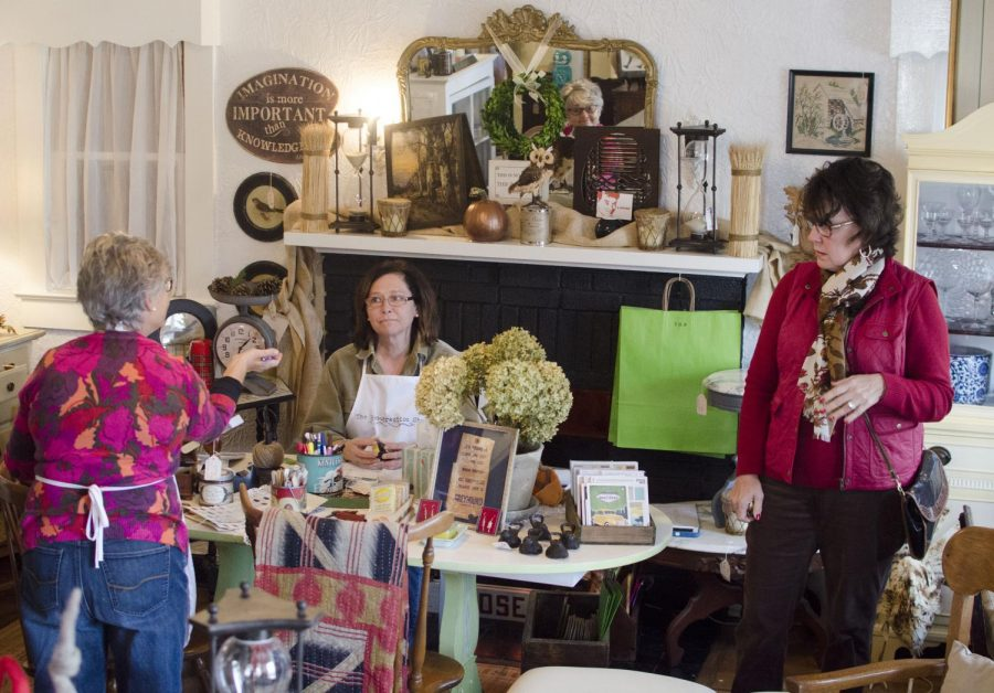 Mary Dale Reynolds (left) and Margaret Baker (center), the owners of The Resurrection Shop, show Linda Vitale around the store. It was Vitale's fi rst time in the store and she left impressed with the sheer quantity of goods inside.