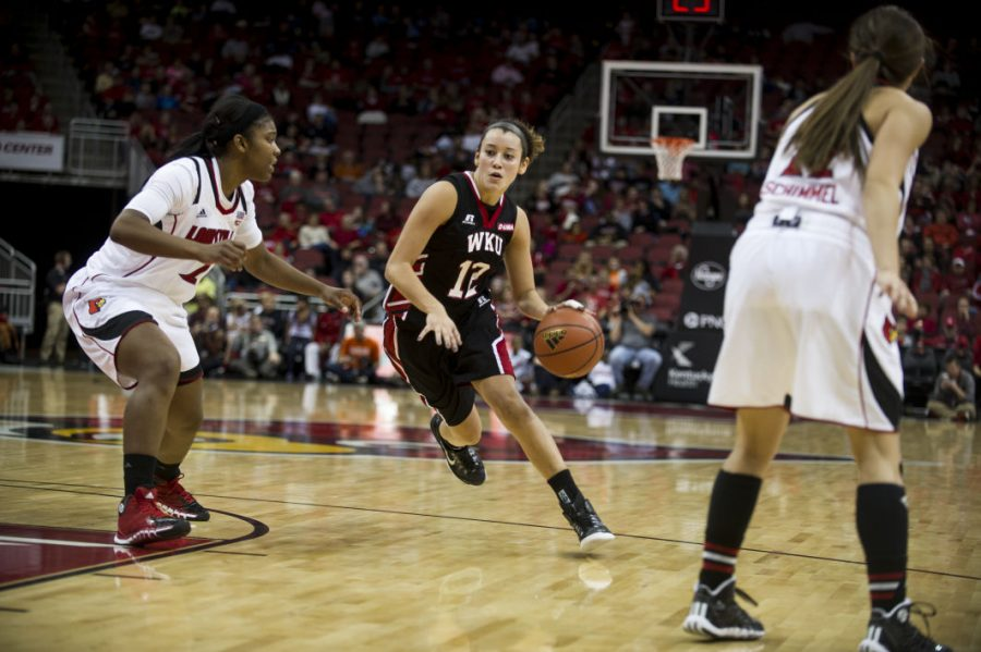 Sophomore Guard Kendall Noble drives the ball to the basket against the University of Louisville at the Yum! Center, November 25, 2014. Justin Gilliland/HERALD November 25, 2014.