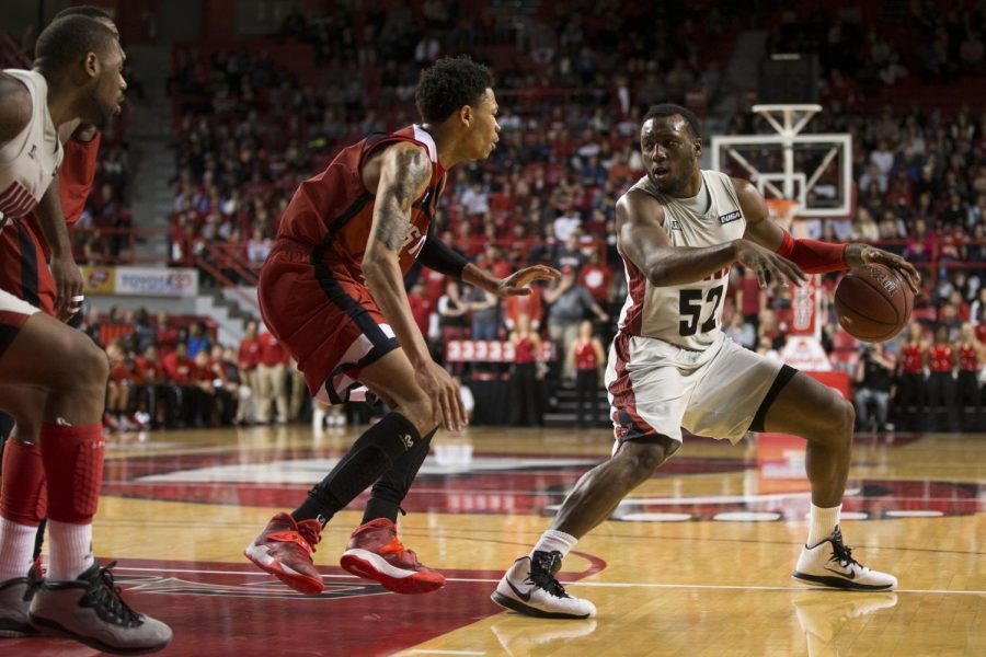 Senior+guard+T.J.+Price+%2852%29+dribbles+out+of+the+lane+during+the+second+half+of+WKU%27s+game+against+Austin+Peay+on+Saturday.+Price+led+all+scorers+with+22+points+and+was+a+perfect+4-4+from+three-point+range+as+WKU+defeated+the+Governors%2C+77-70.+Brandon+Carter%2FHERALD