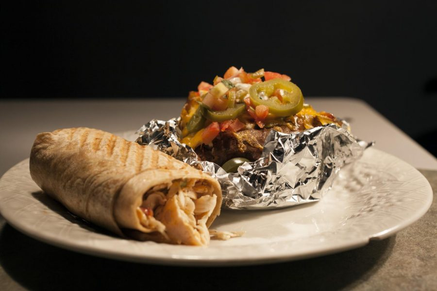 A+fajita+potato+layered+with+chicken%2C+saut%C3%A8ed+onions+and+green+peppers%2C+sliced+jalapenos%2C+diced+tomatoes+and+smothered+in+melted+cheddar+cheese+is+paired+with+a+wheat+ranchero+wrap+at+Griff+s+Deli.+The+restaurant+is+located+at+1640+Scottsville+Rd.+Alyssa+Pointer%2FHERALD