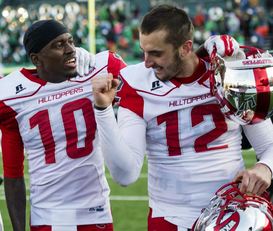 WKU quarterback Brandon Doughty (12) pumps his fist with teammate Willie McNeal (10) after the Hilltoppers upset No. 19 Marshall in Huntington, West Virginia, with an overtime victory, 67-66. Doughty connected with McNeal on a two-point conversion try to win the game.Nick Wagner/HERALD