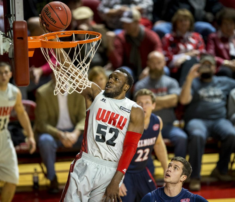 Senior guard T.J. Price (52) makes a layup during WKUs 63-64 loss against Belmont Saturday, Nov. 22, 2014, at E.A. Diddle Arena in Bowling Green, Ky. Price played all 40 minutes of the game and scored 15 points. Mike Clark/HERALD