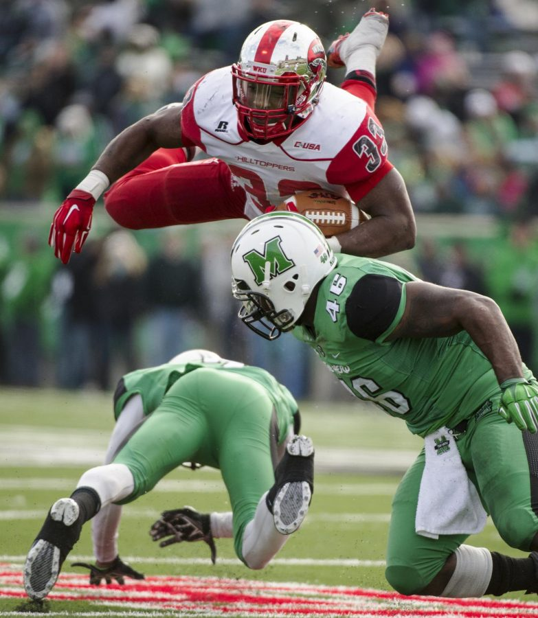 WKU%27s+Leon+Allen+soars+through+the+air+during+Saturday%27s+game+against+No.+19+Marshall+in+Huntington%2C+West+Virginia.+Allen+rushed+for+a+game-high+237+yards+and+a+touchdown.%C2%A0Nick+Wagner%2FHERALD
