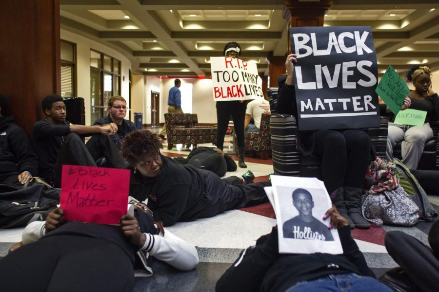 WKU students and faculty, including WKU Political Science Professor and Department head Dr. Saundra Curry Ardrey (center), individually participate in a die-in in the Downing Student Union inn campus December 10, 2014.