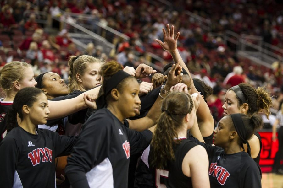 The+Lady+Toppers+gather+before+the+second+half+of+their+game+against+the+University+of+Louisville+at+the+Yum%21+Center%2C+November+25%2C+2014.+Justin+Gilliland%2FHERALD